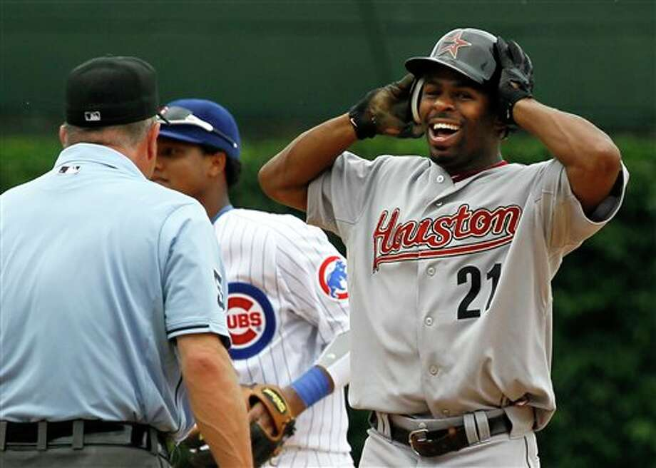 Houston Astros' Michael Bourn, right, reacts towards second base umpire Dale Scott, left, after being caught stealing second during the inning of a baseball game against the Chicago Cubs Saturday, July 23, 2011 in Chicago. (AP Photo/Charles Rex Arbogast) Photo: Associated Press