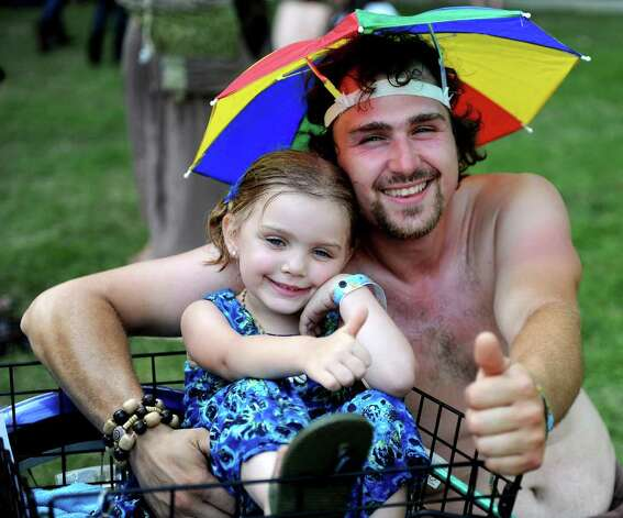 Michael Corcoran of Albany poses for a photo with his daughter, Willow, during The Gathering of the Vibes on Saturday, July 23, 2011. Photo: Lindsay Niegelberg / Connecticut Post Staff