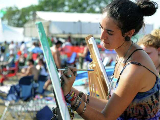 Hila Sid of Brooklyn paint en plain air during the Gathering of the Vibes on Saturday, July 23, 2011. Photo: Lindsay Niegelberg / Connecticut Post Staff
