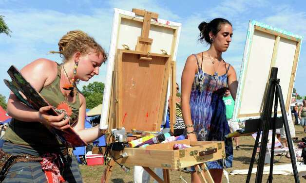 Natasha Jacobs of Manhattan, left, and Hila Sid of Brooklyn, right, paint during the Gathering of the Vibes on Saturday, July 23, 2011. Photo: Lindsay Niegelberg / Connecticut Post Staff