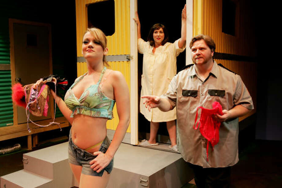 Brooke Wilson plays troublemaking Pippi, from left, Melodie Smith is agoraphobic housewife Jeannie, and David George is Jeannie's erring husband, Norbert, in Stages Repertory's The Great American Trailer Park Musical. Photo: Bruce Bennett, Stages Repertory Theatre