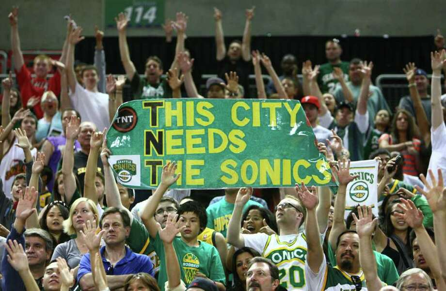 Fans raise a banner during the H206 basketball game at KeyArena in Seattle on Saturday, July 23, 2011. The game, which brought Seattle basketball legends back to the local hardwood, was a fundraiser for A PLUS Youth Programs. Photo: JOSHUA TRUJILLO / SEATTLEPI.COM