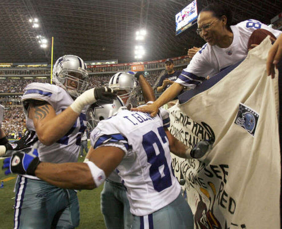 Terry Glenn (center) celebrates his fourth quarter touchdown. Photo: MATT SLOCUM, AP