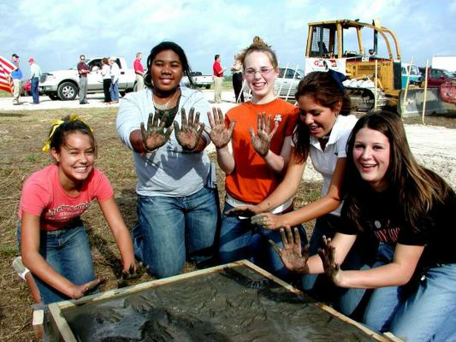 Following a Goose Creek tradition, students from district junior highs were selected to place their handprints in concrete for display at the new high school where the district held a groundbreaking Friday. Students selected were, from left, Jasmine King, Highlands Junior; Raven Graves, Horace Mann Junior; Ratey Brownlee; Gentry Junior, Erin Yzquierdo, Cedar Bayou Junior; and Nichole Nerf, Baytown Junior High. Photo: Fannie Williams, For The Chronicle
