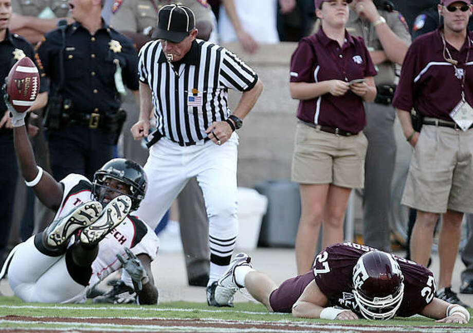 Tech scored a TD in the final seconds of the game to stunned fans in Kyle Field. Photo: Billy Smith II, HOUSTON CHRONICLE