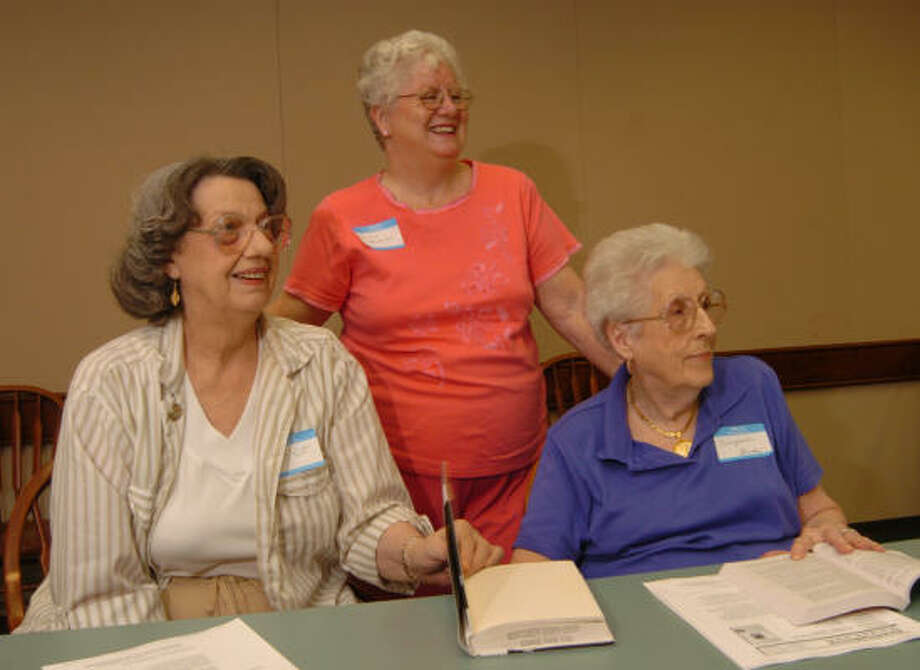 Joyce Thomas, left, Shirley Edwards and Virginia Brady listen to book discussions as the Book Club for Seniors gathers at the Central Library in Conroe. Photo: David Hopper, For The Chronicle