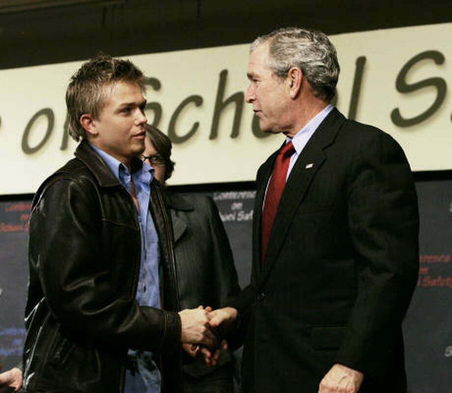 President Bush, right, shakes hands with Columbine High School massacre survivor Craig Scott after a summit on school violence on Tuesday in Chevy Chase, Md. Photo: CHARLES DHARAPAK, AP