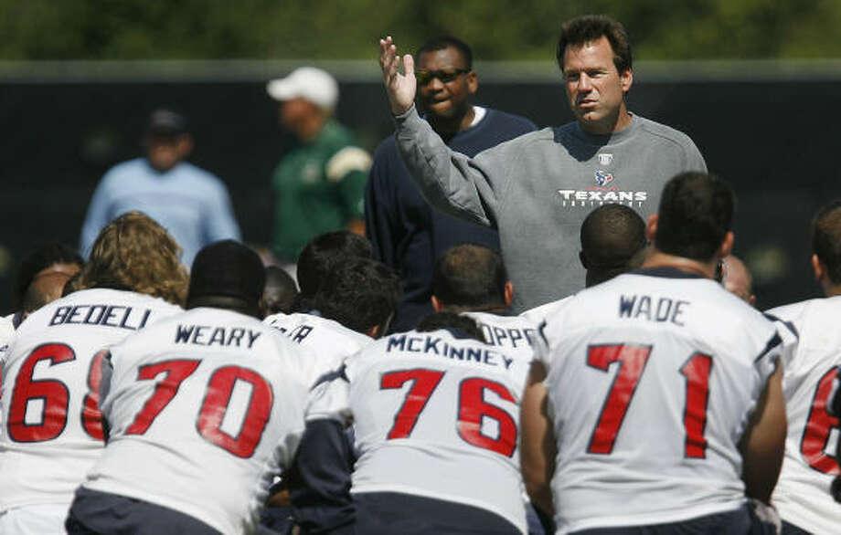 Texans coach Gary Kubiak has taken the bull by the horns, so to speak. Photo: Mayra Beltran, Houston Chronicle