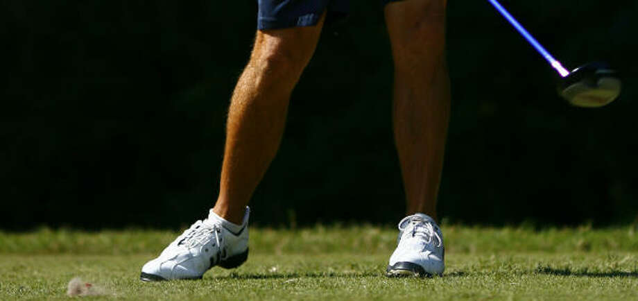 Golf pros may wear metal spikes while most people wear plastic. Either type of golf shoe can benefit to a player's game. Photo: Steve Ueckert, Houston Chronicle