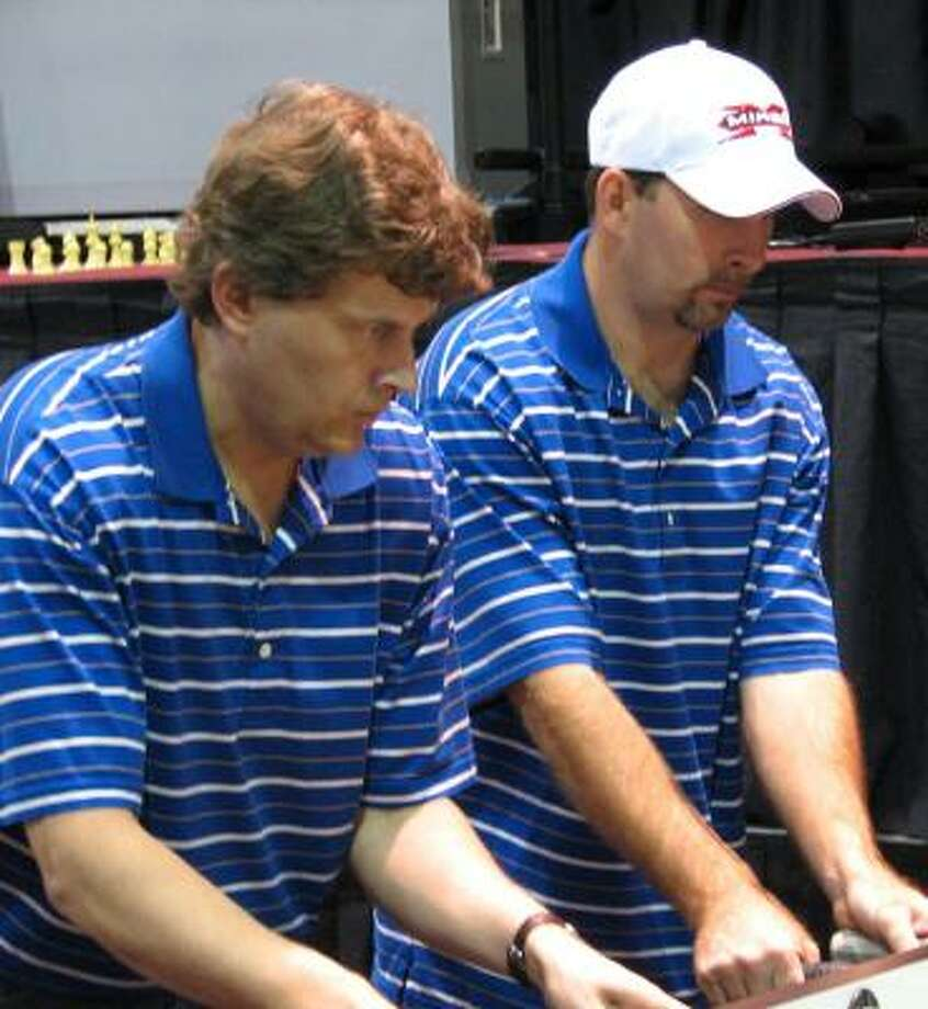 La Porte's Tracy McMillin, right, focuses on the table along with partner Dave Gummeson on the way to winning the world championship in the Open Doubles Division at the Tornado World Championships of Table Soccer in Las Vegas at the Riviera Hotel and Casino in September. Photo: Courtesy Cissy Whipple, For The Chronicle