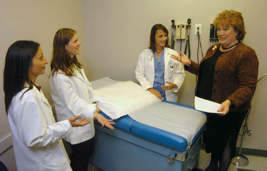 Noushin Hart, left, Marra Francis and Sabrina Lahiri get a tour of the facilities at the Community Clinic in Oak Ridge North from Rebecca Jones, executive director of the Community Clinic. Photo: David Hopper, For The Chronicle