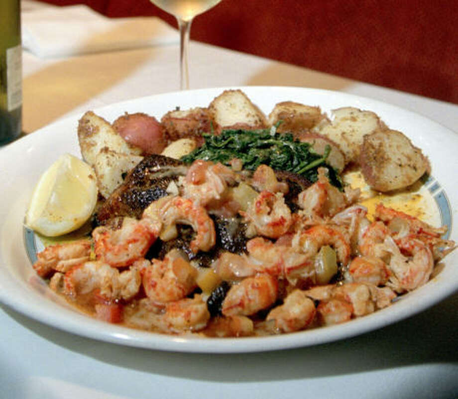 Recent kudos goes to State Grille's beef, but the eatery also serves fare like this plate of crawfish tails, toma-toes and catfish fillets blackened and topped with a lemon-butter sauce. Photo: Melissa Phillip, Chronicle
