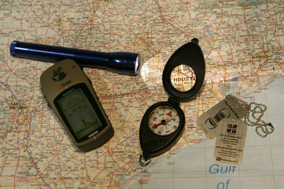 Tools that come in handy for geocaching include GPS units, maps, compasses and flashlights. Photo: Carlos Antonio Rios, Houston Chronicle