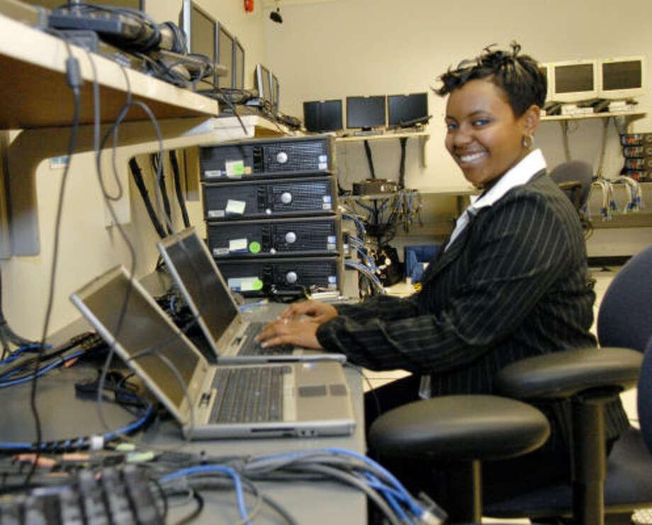 Queen Chambliss, 17, works on a computer at the United Space Alliance in Clear Lake. Photo: Kim Christensen, For The Chronicle