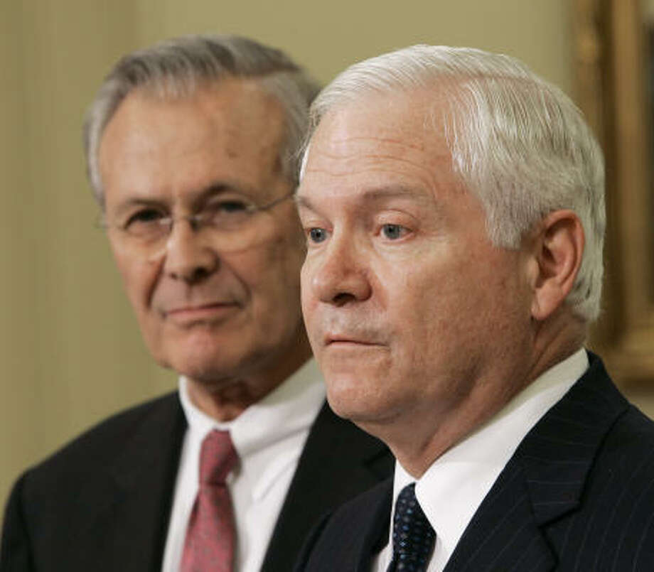 Robert Gates, President Bush's nominee for defense secretary, right, accompanied by outgoing Defense Secretary Donald H. Rumsfeld, speaks in the Oval Office of the White House in Washington. Photo: GERALD HERBERT, AP