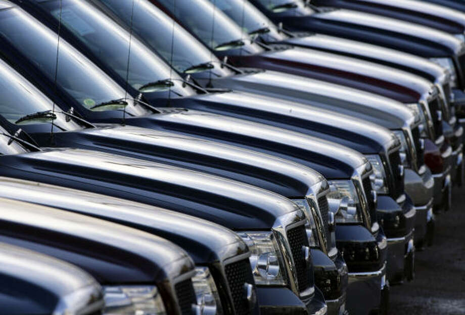 Ford F-150 pickups await customers in the Denver suburb of Centennial, Colo. Ford's pickup trucks have long been No. 1 in the U.S., but that position is threatened by GM and Toyota. Photo: DAVID ZALUBOWSKI, AP