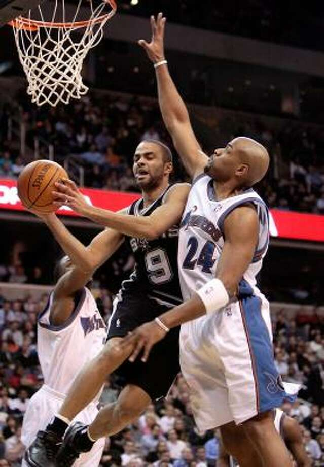The Spurs' Tony Parker, who had 20 points, slices through the Wizards' Gilbert Arenas, left, and Jarvis Hayes. Photo: HARRY E. WALKER, MCCLATCHEY TRIBUNE