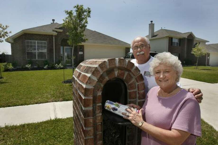 Ronnie and Sharon Naiser recently retired and bought a newly built house last year so they wouldn't have to worry about repairs. Photo: Carlos Antonio Rios, Chronicle