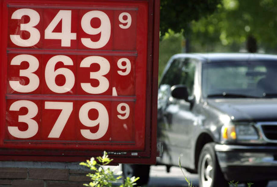 Although gasoline prices, like these posted Sunday in Denver, continue to spiral upward, the federal trust fund that pays for highways and bridges is facing a looming cash shortage. Photo: David Zalubowski, AP