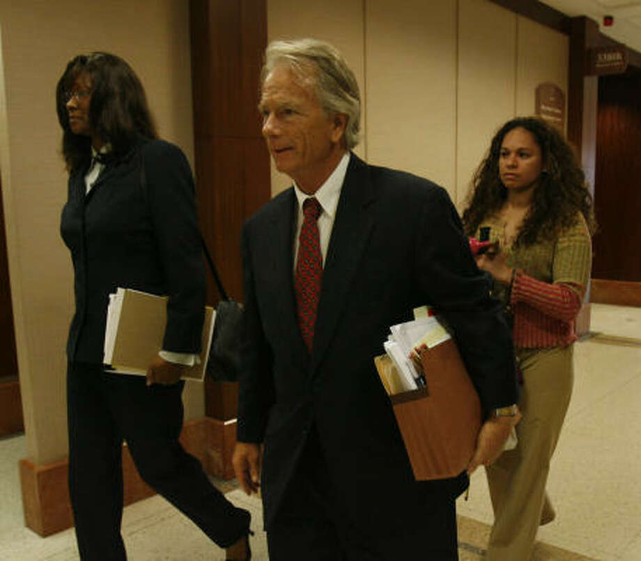 Attorney Mike DeGeurin walks down the hall with his client, former TSU  President Priscilla Slade, during a break this week in the 338th State District Court at the Harris County Criminal Courthouse. Photo: Karen Warren, Houston Chronicle