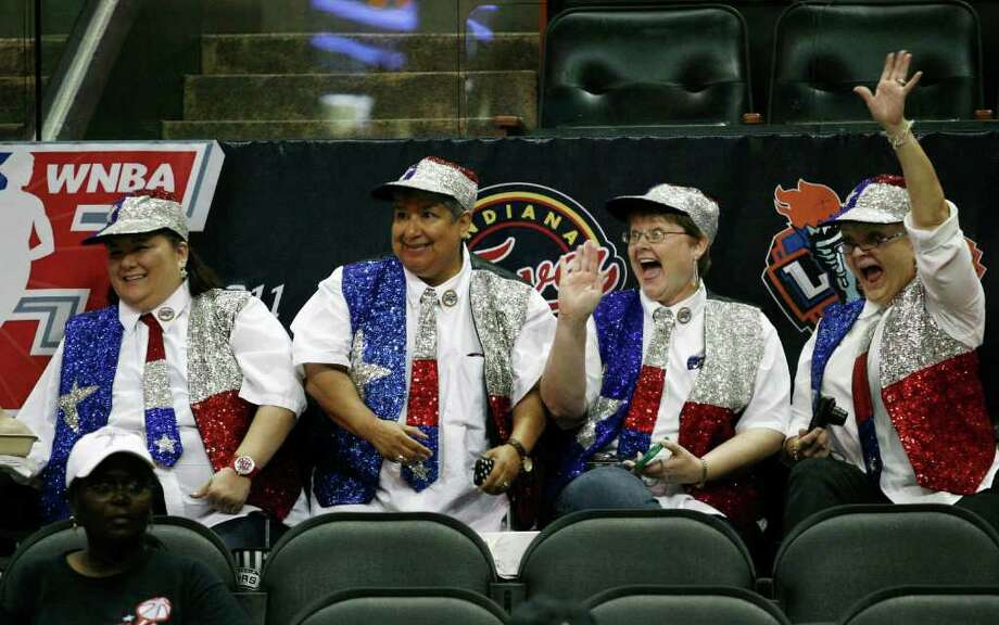 Fans Peggy Arp (from left), Espe Garcia, Suzanne Kenoyer and Jackie Freeman cheer and wave before the WNBA All-Star game on Saturday, July 23, 2011, at the AT&T Center. Photo: Darren Abate, Darren Abate/Associated Press / FR115 AP