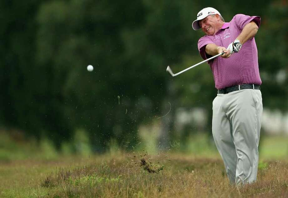 TADWORTH, ENGLAND - JULY 23:  Mark Calcavecchia of the USA in action during the third round of the Senior Open Championship at Walton Heath Golf Club on July 23, 2011 in Tadworth, England.  (Photo by Andrew Redington/Getty Images) Photo: Andrew Redington