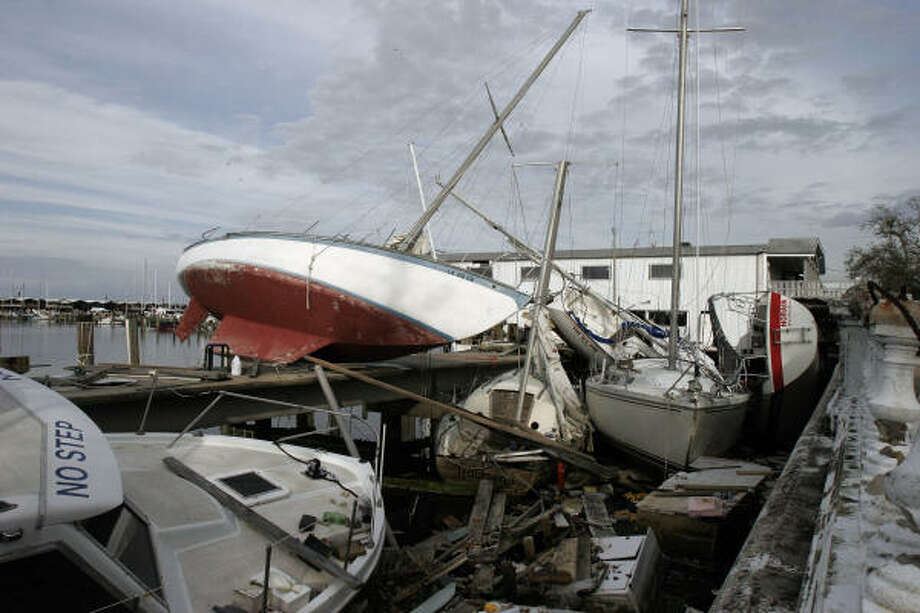 Problems, like these boats at the Municipal Yacht Harbor, just keep mounting in New Orleans, which is plagued by a higher crime rate and fears about the safety of its levees. Some residents have lost hope. Photo: Bill Haber, AP