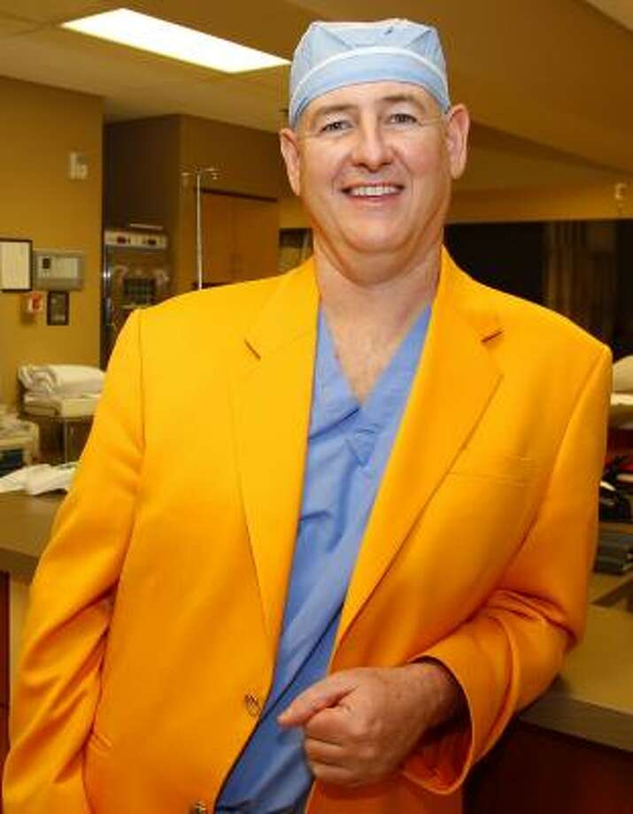 "When Dr. Paul Thomas could not find a ""Tennessee orange"" blazer like Vols coach Bruce Pearl wears, Thomas took matters into his own hands — he started a company to make them. Photo: DONN JONES, ASSOCIATED PRESS"