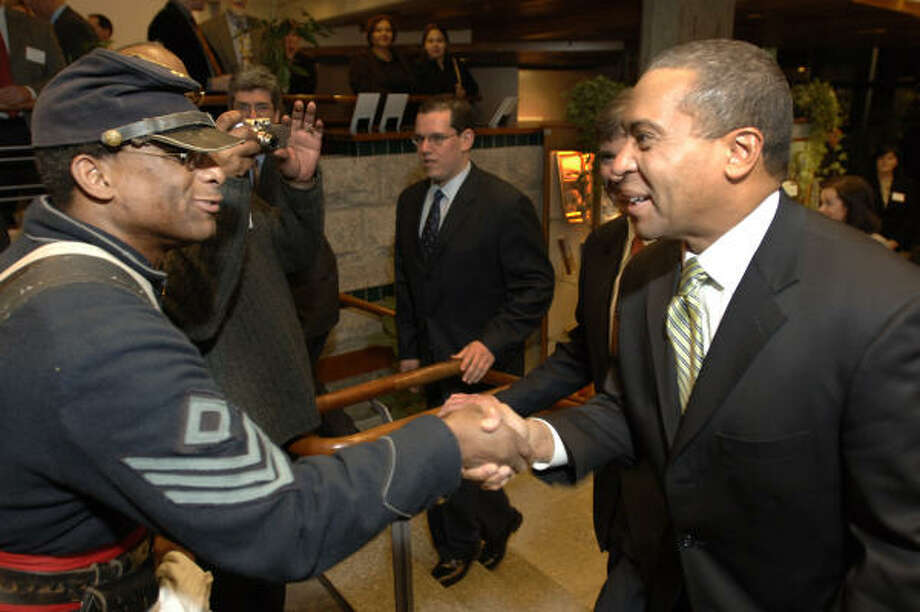 Massachusetts Gov. Deval Patrick, right, greets Gerard Grimes, during a Feb. 7 exhibit at the Massachusetts Archives and Commonwealth Museum dedicated to the role of blacks in the Civil War. Photo: Josh Reynolds, AP