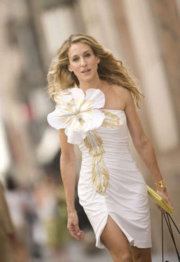 Sex and the City's Carrie Bradshaw (Sarah Jessica Parker) always looks fantastic in her designer dresses. Photo: Craig Blankenhorn, New Line Cinema