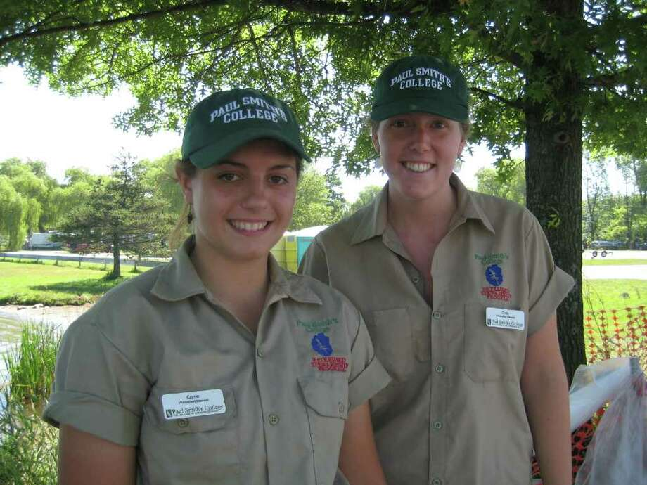 Corrie Mersereau, left, and Emily Russell work as lake stewards at Saratoga Lake. (Leigh Hornbeck/Times Union)