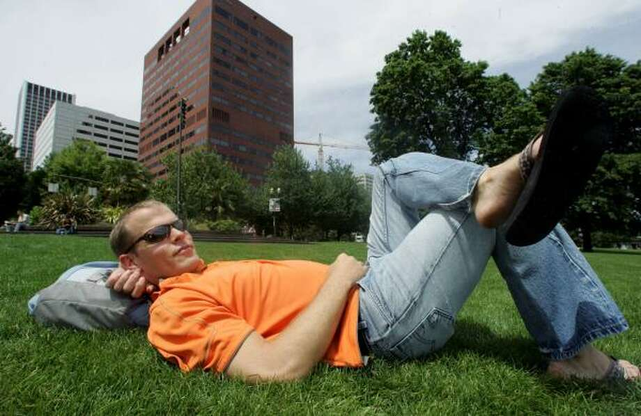 Tim Ferriss relaxes in downtown Portland, Ore. The author of The Four-Hour Workweek says he deploys virtual assistants to handle his routine chores, even finding and scheduling dates for him online. Photo: RICK BOWMER, ASSOCIATED PRESS