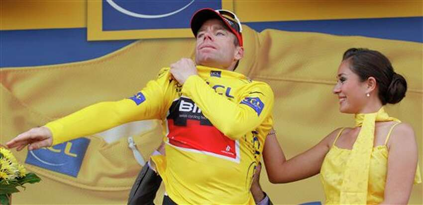 New overall leader Cadel Evans of Australia adjusts the yellow jersey on the podium of the 20th stage of the Tour de France cycling race, an individual time trial over 42.5 kilometers (26.4 miles) starting and finishing in Grenoble, Alps region, France, Saturday July 23, 2011. (AP Photo/Christophe Ena)