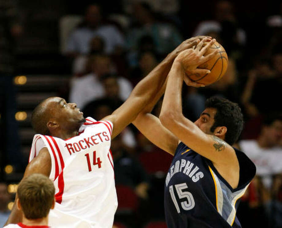 The Rockets feel they can be selective with the preseason appearances of Carl Landry, left. Photo: Nick De La Torre, HOUSTON CHRONICLE