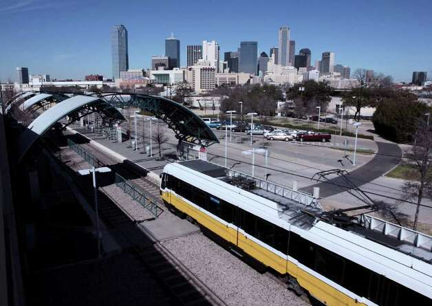 A Dallas Area Rapid Transit light-rail train arrives at the Cedars station south of the city center. The station serves the system's Red and Blue lines. Photo: Courtesy Photo