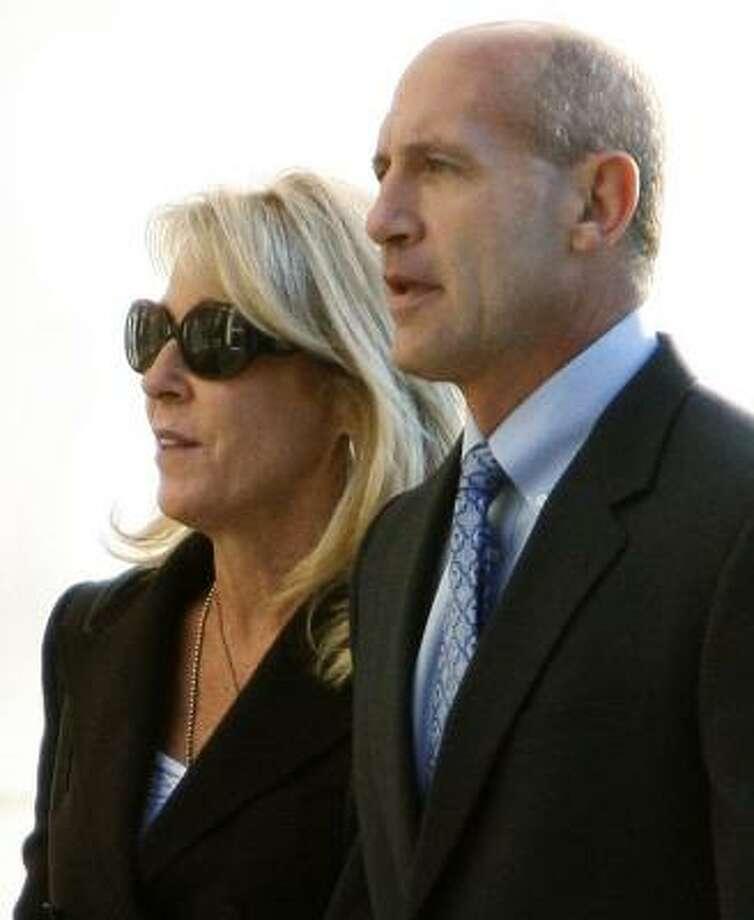 Former Orange County Sheriff Mike Carona heads to court with his wife, Deborah, in Santa Ana, Calif., on Wednesday. Photo: KEN STEINHARDT, ORANGE COUNTY REGISTER