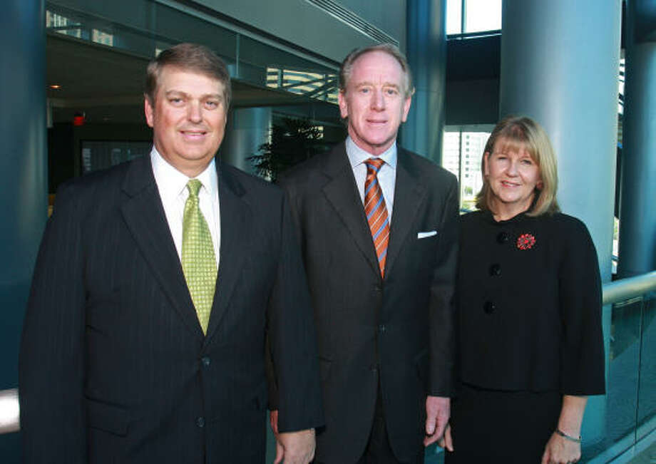 Phil Conway, from left, Archie Manning and Suzie Conway Photo: Gary Fountain, For The Chronicle
