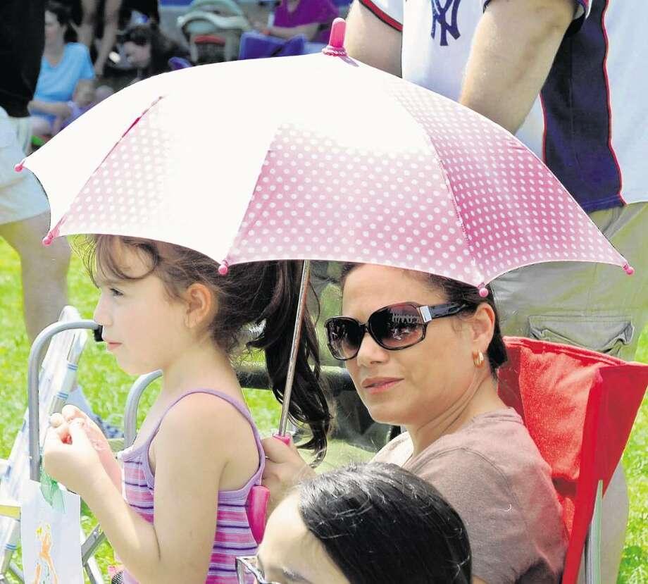"Gianna Casturani, 5, and her mom, Veronica Casturani from Danbury, enjoy ""Peter Pan."" Photo: Lisa Weir"