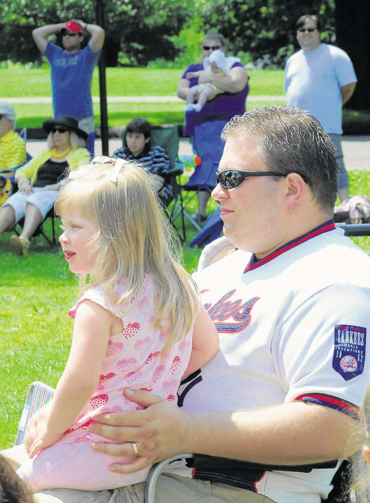 Aaliyah Frank, 3, and her dad, Brian Frank, of Danbury, watch Fairy Tale Theater's performance of