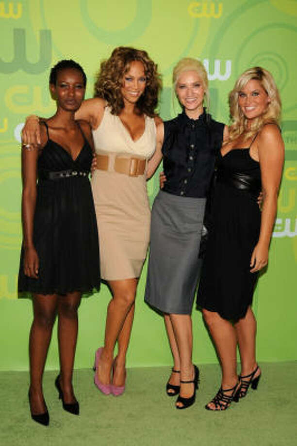 Tyra Banks, in beige, poses with former America's Next Top Model contestants, from left, Fatima, Anya and Whitney at Lincoln Center on May 13, 2008 in New York City. Photo: Bryan Bedder, Getty Images