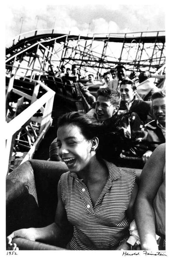Harold Feinstein (American, b. 1931)  Girl On Cyclone - Coney Island, NY, 1952  Gelatin silver print on paper  11 x 7 inches  (Gift of Marvin & Carol Brown to University at Albany Foundation Collection)