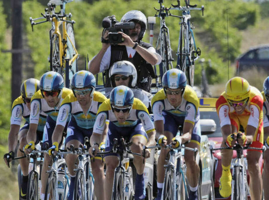 Alberto Contador of Spain, right, and Lance Armstrong, far left half hidden, ride with their Astana teammates during the fourth stage. Photo: LAURENT REBOURS, AP