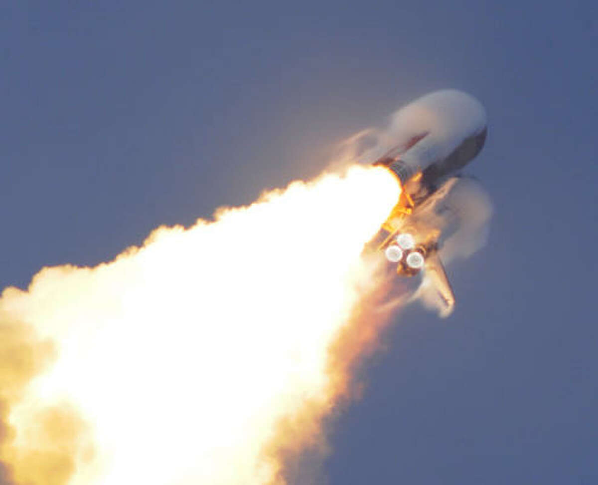 Water vapor surrounds the U.S. space shuttle Endeavour during liftoff on Wednesday.