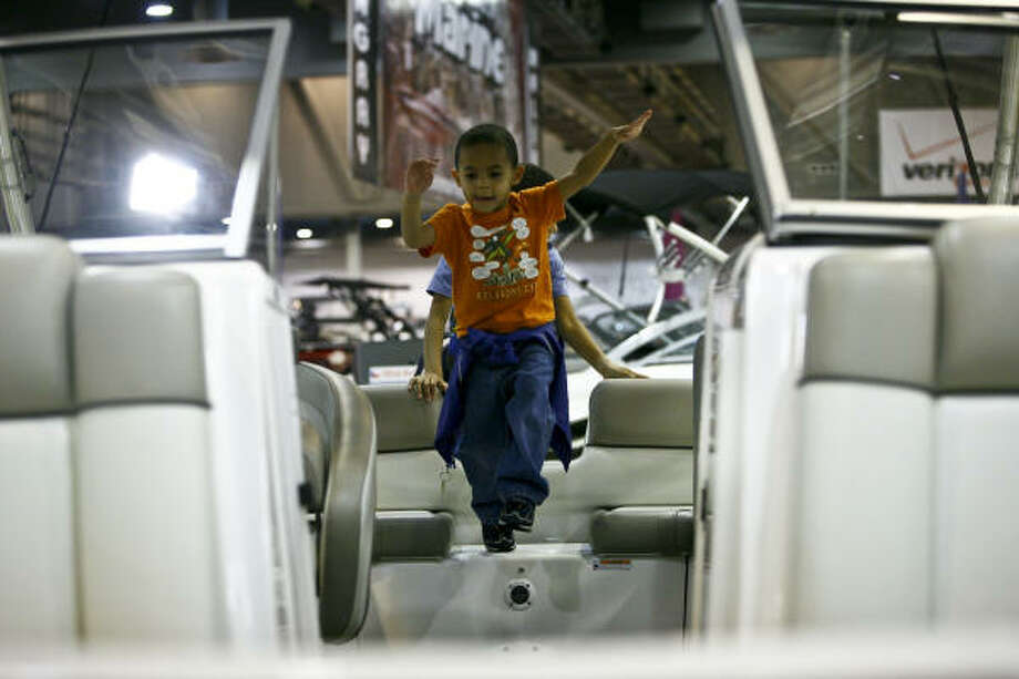Four-year-old Palmer Gittings takes delight in being in a boat while visiting the 2010 Houston International Boat Show at Reliant Center on Friday. Boats costing $2 million and up were absent this year. The largest Boat Show on the Gulf Coast with more than 1,000 powerboats, luxury yachts, sailboats, and personal watercraft, plus over 300 exhibits. Photo: Michael Paulsen, Chronicle