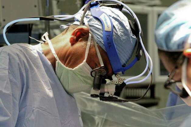 Dr. Bennett, left, and team, perform open heart surgery at Albany Medical Center on Thursday, July 14, 2011. (Erin Colligan / Special To The Times Union)