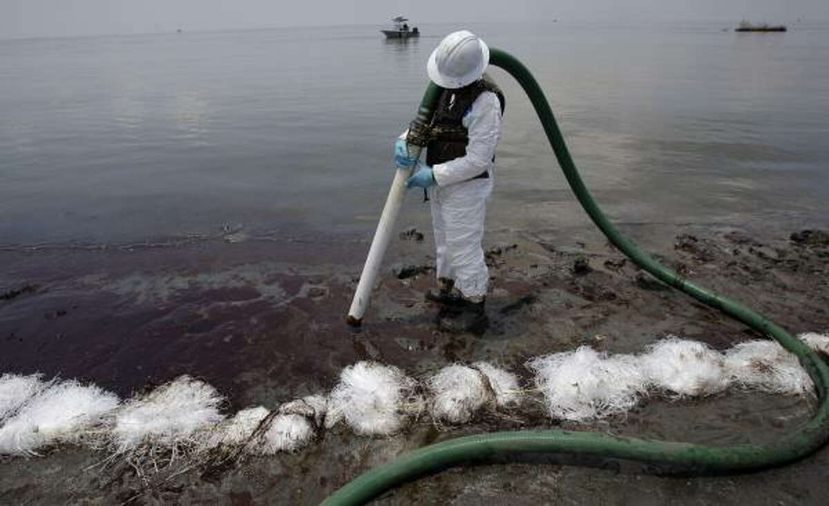 While efforts to deal with surging oil continue Wednesday out in the Gulf, cleanup work on shore — as in Belle Terre, La. — mainly depends on individuals wielding suction hose.