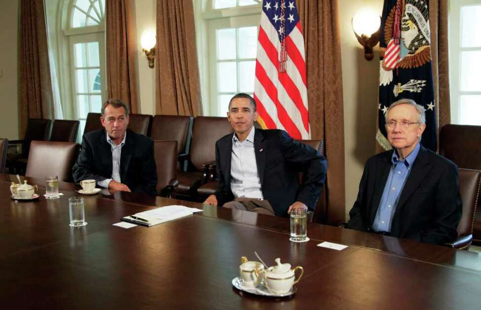 President Barack Obama meets with Senate Majority Leader Harry Reid of Nev., right, and House Speaker John Boehner of Ohio, left, in the Cabinet Room of the White House, Saturday, July 23, 2011, in Washington, to discuss the debt. (AP Photo/Carolyn Kaster)