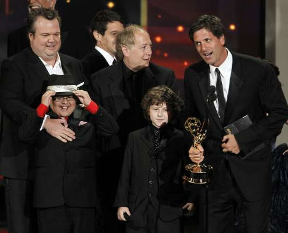 Creator Steven Levitan and some of the cast from ABC's Modern Family accept the award for outstanding comedy series. Photo: Chris Carlson, AP