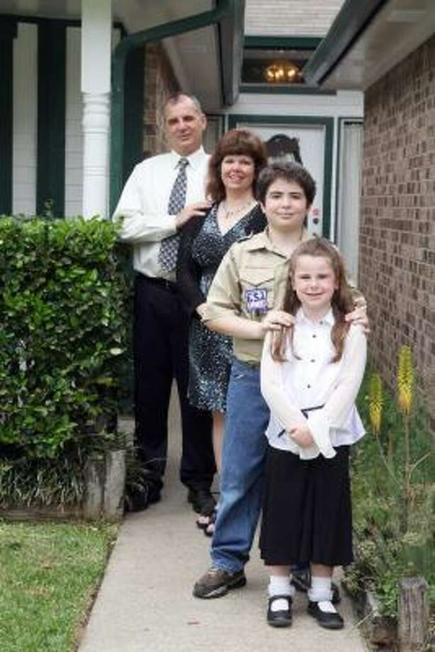 HOMEFRONT: Michael and Paula Zikogiannis, with their children, Avery and Madelyn, bought their home because of the reputation of Pasadana ISD. Photo: Pin Lim, For The Chronicle