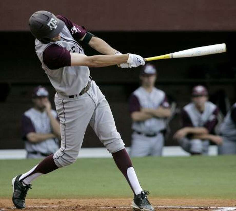 A&M's Matt Juengel hits a home run against Florida State during Game 1 of the super regional series on Saturday. Photo: Steve Cannon, Associated Press